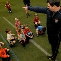 Dave O'Brien, coach of the Arkansas Comets Futbol Club, tells children Tuesday about the next game t...