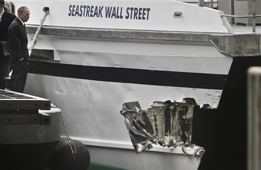 mayor-michael-bloomberg-surveys-the-damage-to-a-passenger-ferry-after-it-crashed-on-wednesday-jan-9-2013-in-new-york-at-least-57-people-were-injured-two-critically-when-a-commuter-ferry-struck-a-dock-in-new-york-citys-financial-district-ripping-open-a-right-side-front-corner