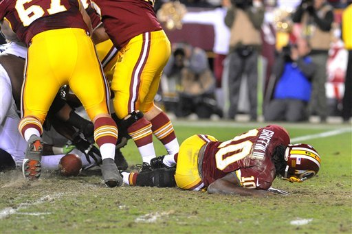 the-ball-is-loose-as-redskins-quarterback-robert-griffin-iii-lays-on-the-field-after-fumbling-the-snap-from-center-against-the-seahawks-during-the-fourth-quarter-of-their-nfl-playoff-football-game-sunday-jan-6-2012-in-landover-md-griffin-left-the-game-with-an-injured-right-leg-seattle-defeated-washington-24-14