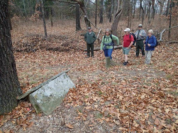 Curtis Tilghman, from left, Linda Heter, Dennis Heter, Patrick Poyner and Mary Chodrick explore a cemetery site during a hike at Pea Ridge National Military Park.