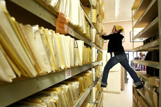 bekah-cone-pulls-a-file-of-old-photos-from-the-shelf-as-she-searches-for-an-original-print-to-ship-to-an-ebay-buyer-at-the-john-rogers-photo-archives-along-north-poplar-street-in-north-little-rock-wednesday