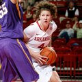 NWA Media/JASON IVESTER -- Arkansas senior Sarah Watkins works around LSU junior Theresa Plaisance d...