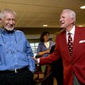 Former Arkansas football coach and athletics director Frank Broyles (right) talks with Loyd Phillips...