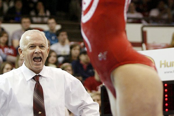 Mark Cook will begin his 11th season as Arkansas' co-head coach on Friday.
