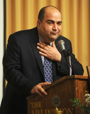 Noted impersonator Frank Mirahmadi, entering his second season as Oaklawn Park's track announcer, does his best Rodney Dangerfield during a recent speaking engagement.