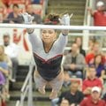 NWA Media/ANDY SHUPE -- Arkansas freshman Heather Elswick competes on the bars during a meet with Ge...