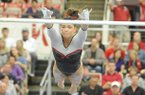 NWA Media/ANDY SHUPE -- Arkansas freshman Heather Elswick competes on the bars during a meet with Georgia Friday, Jan. 11, 2013 at Barnhill Arena in Fayetteville.