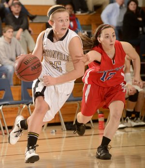 Bentonville's Deanna Adkins, left, shown driving past East Newton (Mo.) defender Shelbey Thomlinson during the 58th annual Neosho (Mo.) Holiday Classic, provides the Lady Tigers with instant offense off the bench.