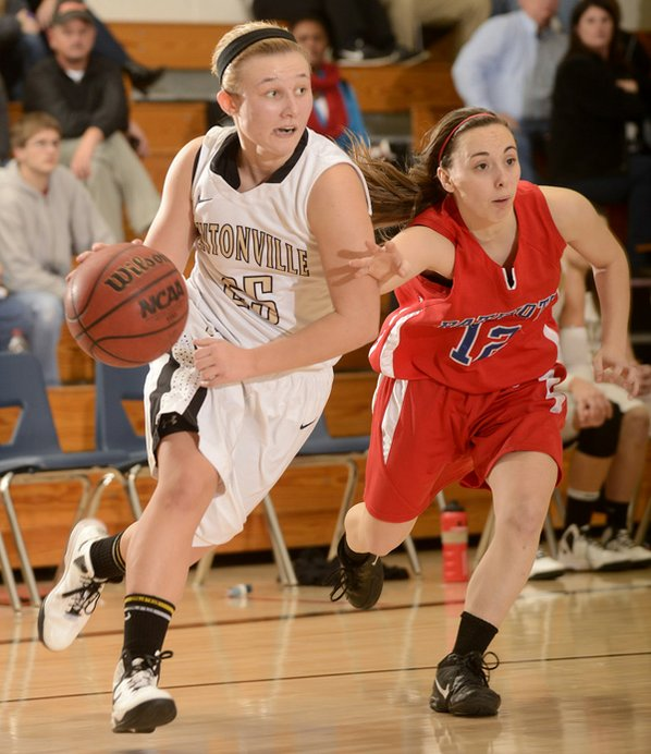 Bentonville's Deanna Adkins, left, shown ...