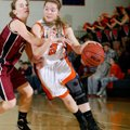 Ashley Ward, a Rogers Heritage senior, tries to drive Tuesday around Springdale High senior Brittany...