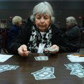 Barbara Davis deals cards Thursday while playing party bridge at the Benton County Senior Activity a...
