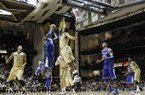 Kentucky forward Nerlens Noel (3) shoots against Vanderbilt forward Sheldon Jeter, center, in the second half of an NCAA college basketball game on Thursday, Jan. 10, 2013, in Nashville, Tenn. Kentucky won 60-58. (AP Photo/Mark Humphrey)