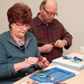 Thom and Ann Johnston are among the students who have learned to make jewelry in Katy Lamm-Rogers' c...