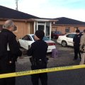 Police talk Friday morning at the scene where two people were killed and one injured in a shooting i...