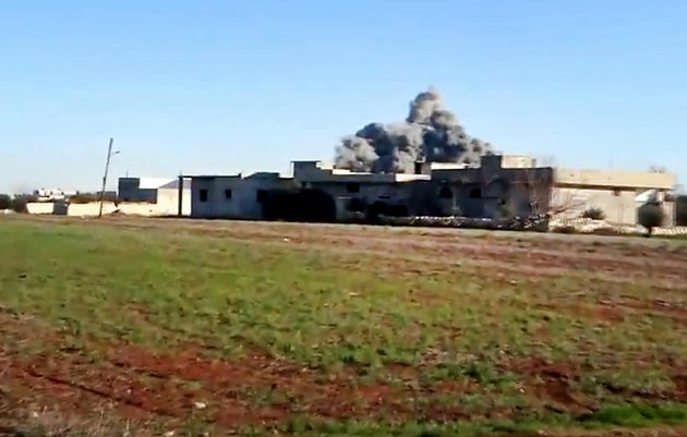 in-this-thursday-jan-10-2013-file-image-taken-from-video-obtained-from-the-shaam-news-network-which-has-been-authenticated-based-on-its-contents-and-other-ap-reporting-smoke-rises-due-to-heavy-shelling-in-taftanaz-idlib-province-northern-syria-syrian-rebels-and-islamic-militants-seeking-to-topple-president-bashar-assad-took-full-control-of-the-taftanaz-air-base-friday-jan-11-in-a-significant-blow-to-government-forces-seizing-helicopters-tanks-and-multiple-rocket-launchers-activists-said