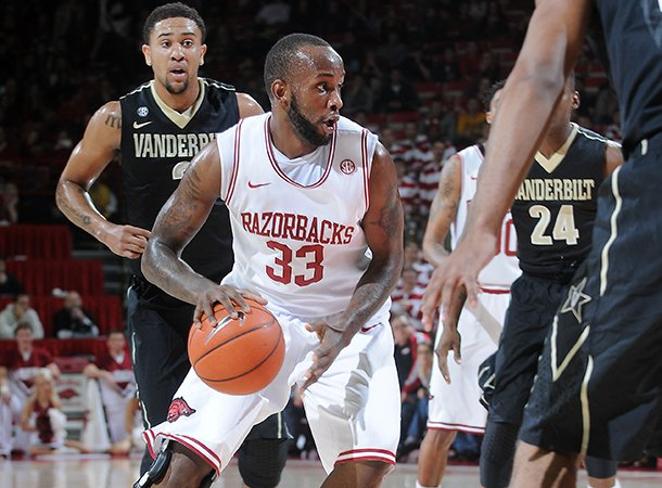nwa-mediasamantha-baker-arkansas-marshawn-powell-drives-into-vanderbilts-defense-saturday-jan-12-2013-during-the-first-half-of-a-game-at-bud-walton-arena-in-fayetteville