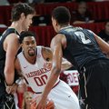 NWA MEDIA/SAMANTHA BAKER -- Arkansas' Rashad Madden, center, keeps close to Kedren Johnson of Vander...