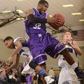 Fayetteville's Manuale Watkins, center, grabs a rebound over Rogers' Xavier Smith, right, and Jake K...