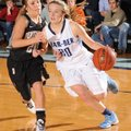 Brooke Mabeus, right, of Bentonville heads toward the basket Friday as Rogers Heritage's Ellen Lundy...