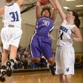 Fayetteville's Catara Robinson, center, makes a jump shot between Rogers' McKinzie James, left, and ...