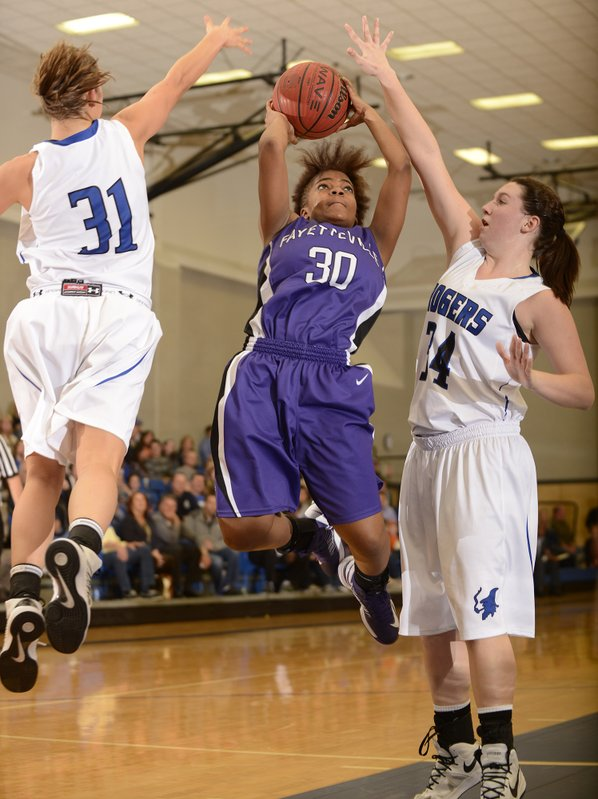 Fayetteville's Catara Robinson, center, makes ...