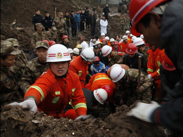 n-this-jan-11-2013-photo-provided-by-chinas-xinhua-news-agency-rescuers-work-at-the-mud-inundated-debris-after-a-landslide-hit-zhaojiagou-in-zhenxiong-county-southwest-chinas-yunnan-province-a-landslide-swept-through-the-village-in-the-steep-snow-dusted-mountains-of-southern-china-on-friday-killing-at-least-32-people-the-local-government-said