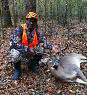 Deion Tidwell's (upper right) first deer was an 8-point buck with a 21-inch spread.