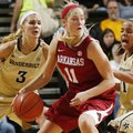 Calli Berna is double-teamed during the Razorbacks' 78-58 loss to Vanderbilt on Sunday at Memorial G...