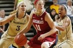 Calli Berna is double-teamed during the Razorbacks' 78-58 loss to Vanderbilt on Sunday at Memorial Gym in Nashville, Tenn.