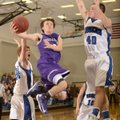 Cameron Paschke, center, Fayetteville, takes the ball to the basket between Rogers High's Jake Killi...