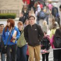 University of Arkansas students cross West Dickson Street in Fayetteville during a class change. A l...