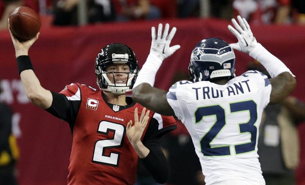 atlanta-falcons-quarterback-matt-ryan-2-throws-against-seattle-seahawks-cornerback-marcus-trufant-23-during-the-second-half-of-an-nfc-divisional-playoff-nfl-football-game-sunday-jan-13-2013-in-atlanta