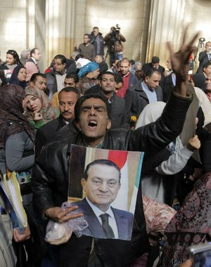 Egyptian supporters of ousted former President Hosni Mubarak celebrate after an appeal of Mubarak's life sentence was granted by a court in Cairo on Sunday.
