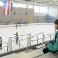Brianne Ginn, 9, of Little Rock, watches the end of the hockey game Sunday between the Northwest Ark...