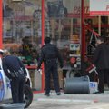Rogers police officers, left, and an employee at the Advance Auto Parts store on Eighth Street in Ro...