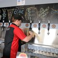 Jesse Core pours a sample beer Friday at his microbrewery, Core Brewing Company, in Springdale. The ...