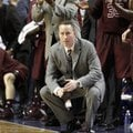 Texas A&M head coach Billy Kennedy, bottom center, watches the closing moments while the bench celeb...