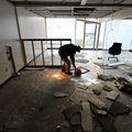 Fayetteville Mayor Lioneld Jordan takes a look around one of the many abandoned rooms at the former ...