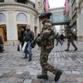 French army soldiers patrol along a main department store in Paris, Tuesday Jan. 15, 2013. Armed sol...