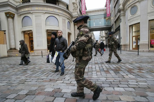 French army soldiers patrol along ...