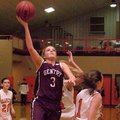 Photo by Randy Moll -- Gentry senior guard Tara Arnold attempts a shot over Gravette senior Destaney...