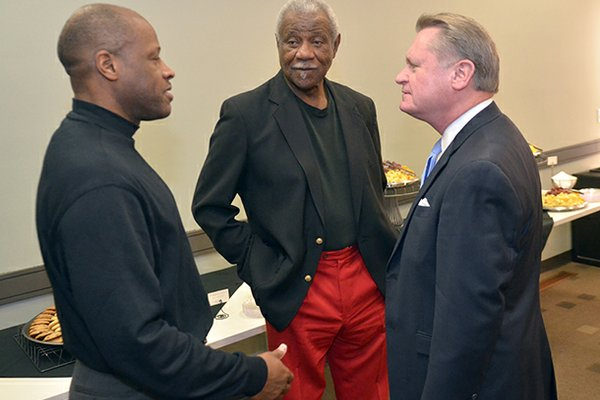 Mike Anderson (left), Nolan Richardson (center) and University of Arkansas chancellor David Gearhart speak during a 2011 event in Fayetteville.