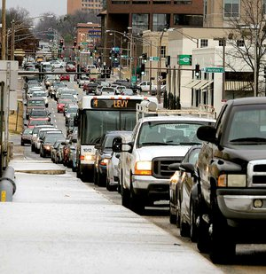 Traffic backs up Tuesday morning in downtown Little Rock as workers leave early because of icy roads.