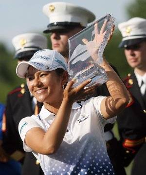 Ai Miyazato holds up the trophy after winning the Walmart NW Arkansas Championship on July 1, 2012 at Pinnacle Country Club in Rogers.