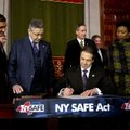 New York Gov. Andrew Cuomo signs a bill toughening gun laws in his state as leading lawmakers gather...