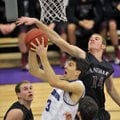 Dylan Gray of Siloam Springs tries to block the shot of Fayetteville's Caleb Waitsman during the fir...