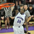 Jawan Smith of Fayetteville goes up for a dunk on a fast break against Siloam Springs on Tuesday at ...