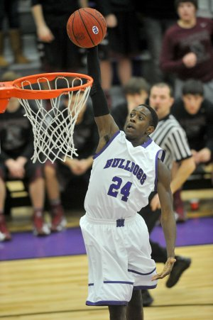 Jawan Smith of Fayetteville goes up for a dunk on a fast break against Siloam Springs on Tuesday at Fayetteville.