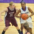 Denesha White of Fayetteville tries to get the ball past Siloam Springs defender Ashlin Stock during...