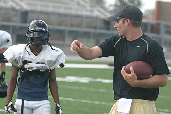 Barry Lunney Jr. spent eight seasons as offensive coordinator at Bentonville High School.
